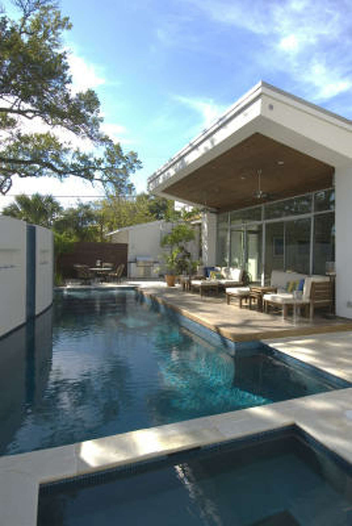 The pool and loggia serve as a nice-weather extension of the living room.