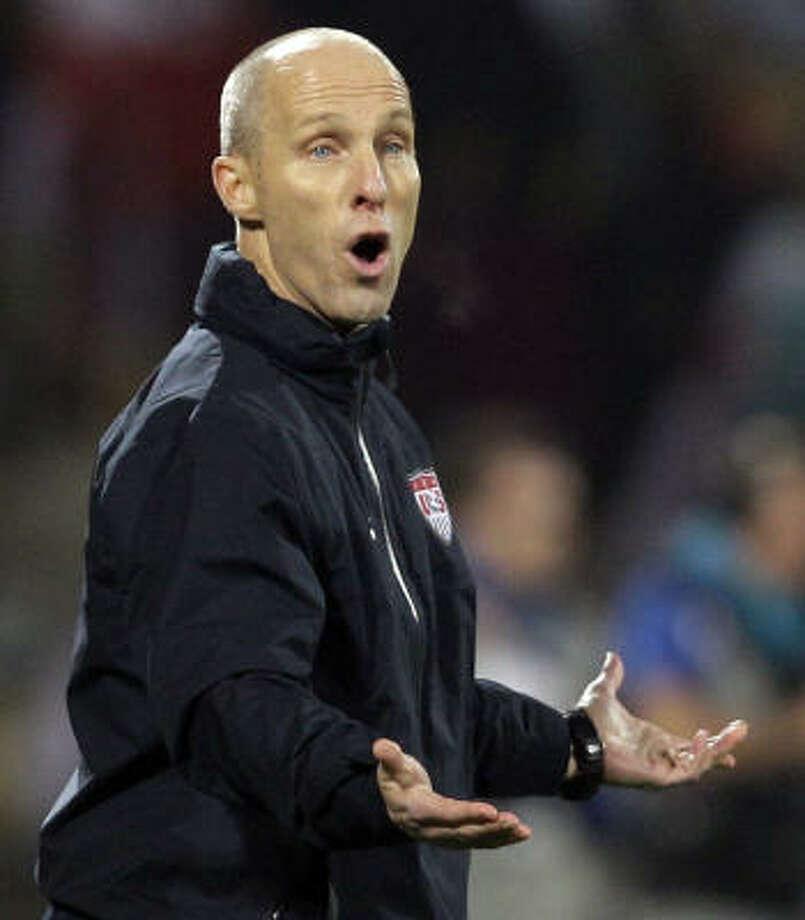 U.S. soccer coach Bob Bradley will continue through 2014. Photo: Elise Amendola, AP