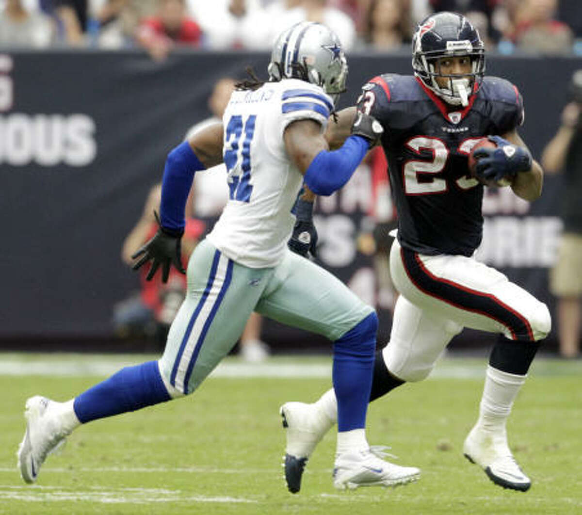 Texans running back Arian Foster runs for a first down against the Cowboys' Mike Jenkins on Sunday.