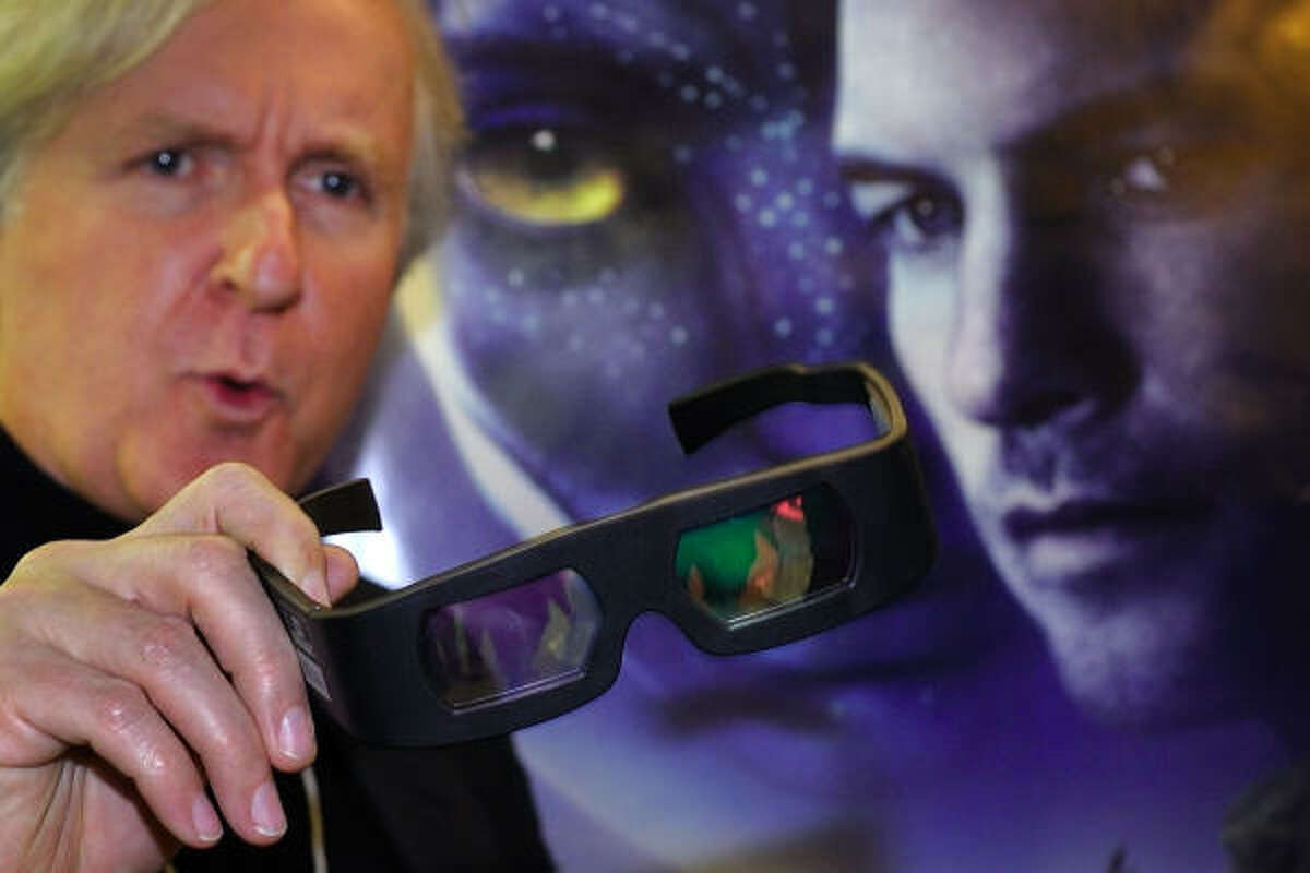 Filmmaker James Cameron, shown on the sidelines of the World Economic Forum in Davos, Switzerland, on Thursday, shows 3-D glasses prior to a screening of his movie Avatar .