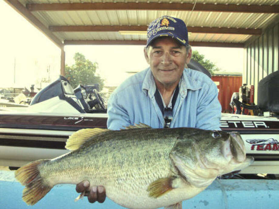 Angler Bryan Aubin of Zapata holds the 14.44-pound largemouth bass he caught from Falcon Lake. Photo: Robert's Fish 'n' Tackle