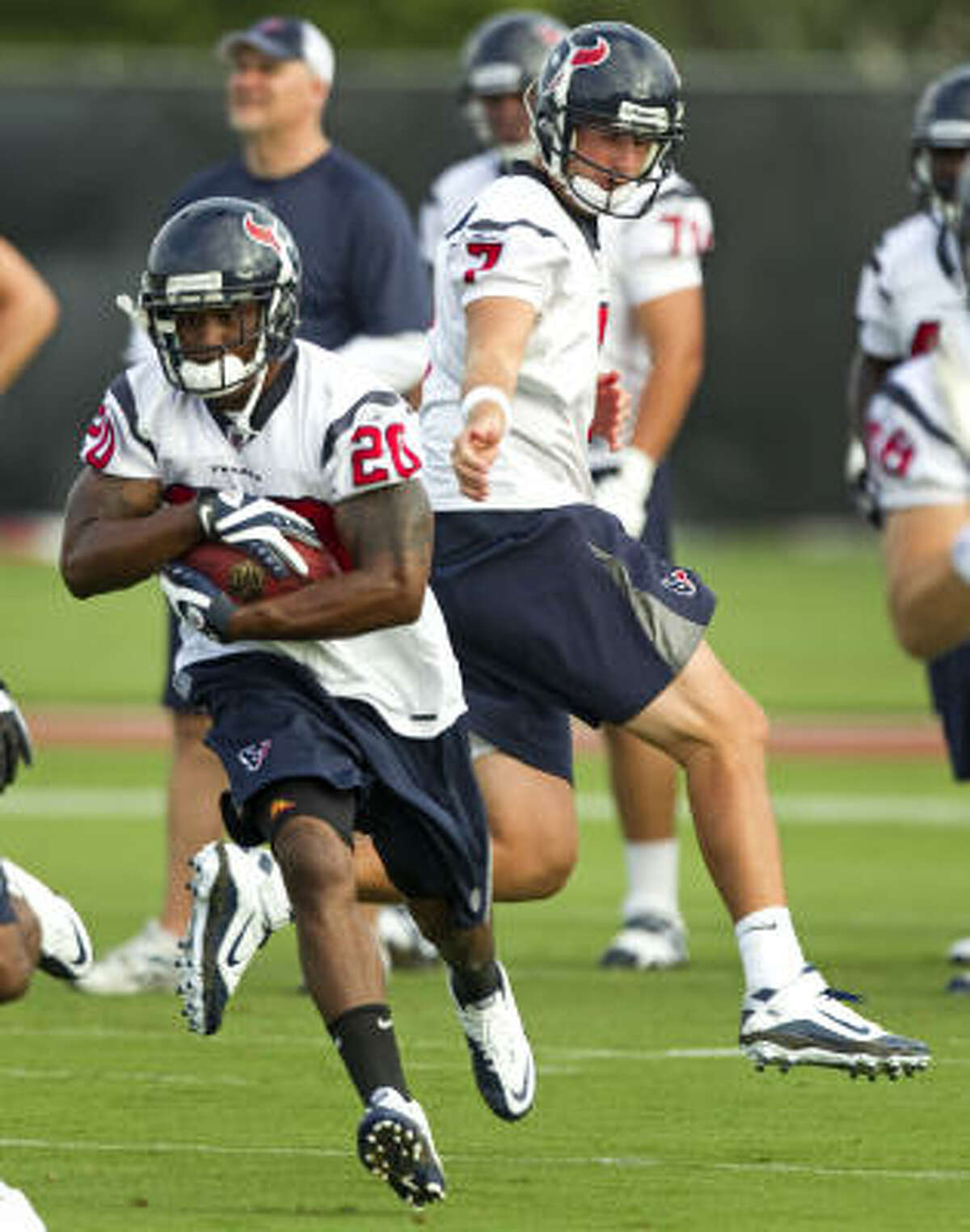 Texans running back Steve Slaton, left, is concerned with improving his numbers from last season, which was shortened because of a neck injury.
