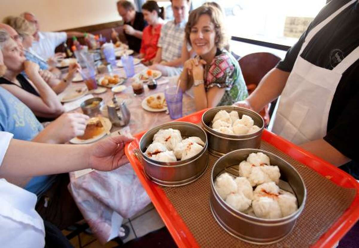 Local foodies enjoy a stop at Hong Kong Dim Sum on a 2010 Where the Chefs Eat culinary tour. The popular tours sold out and had a waiting list of more than 1,000.
