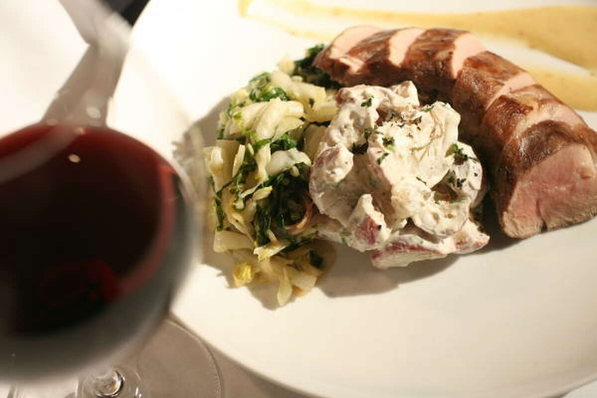 The smoked pork tenderloin plate was cooked just right and is even better when paired with an excellent red burgundy wine.