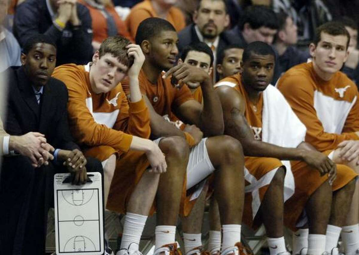 Players on the Texas bench watch during the second half of the road loss to Connecticut.