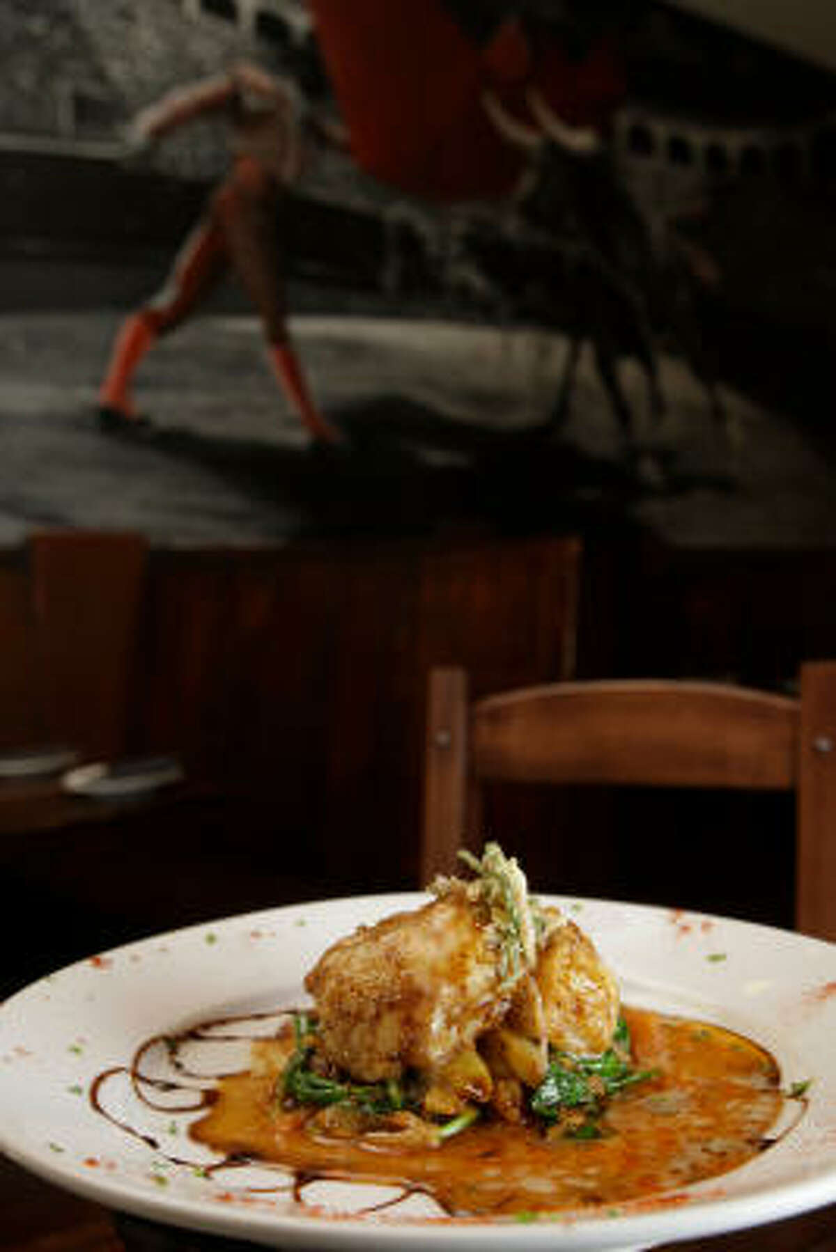 Vieras á la Marbella — sautéed sea scallops — are on the menu at Andalucia Tapas Restaurant & Bar.
