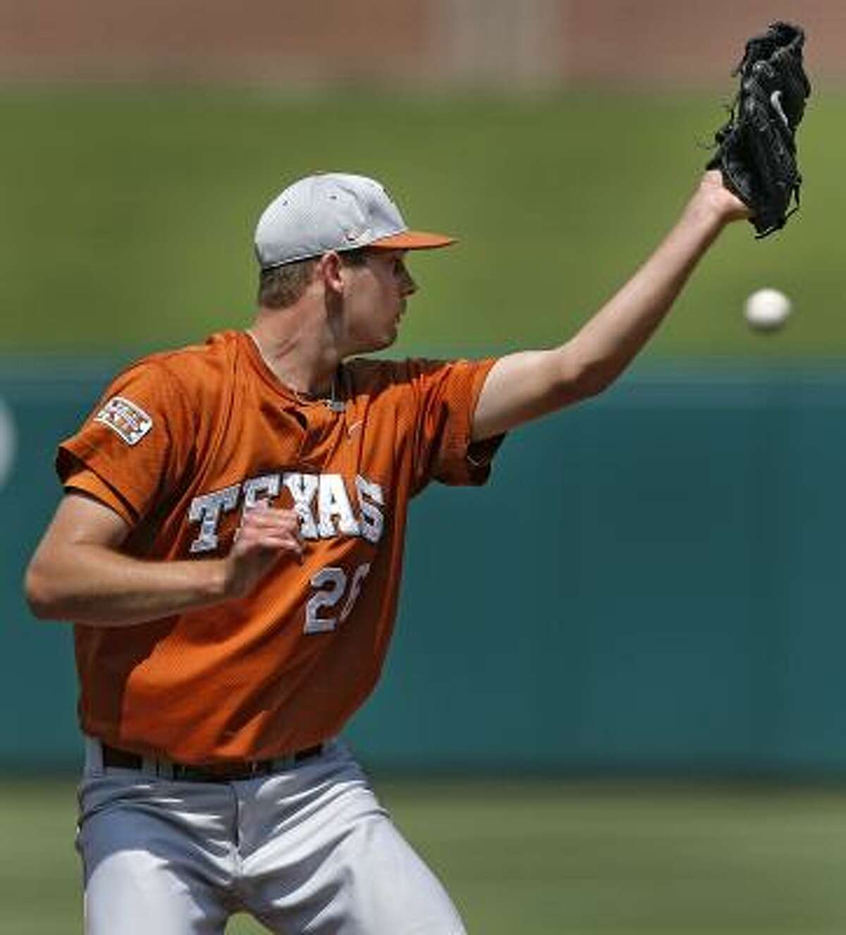 Texas pitcher Taylor Jungmann misses a line drive during the loss to Texas Tech.