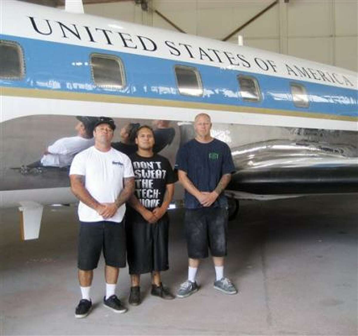 Barry Oloizia, left, Miguel Vazquez and Sean Straube are part of the crew that repainted LBJ's JetStar. The plane will be put on display at the Texas White House near Austin.