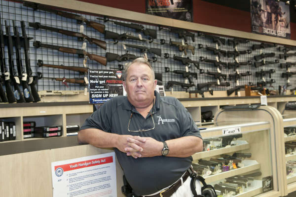 The Arms Room owner Bill James poses in front of the gun counter at the newly opened state-of-the-art gun shop and firing range in League City. Kim Christensen: For the Chronicle.