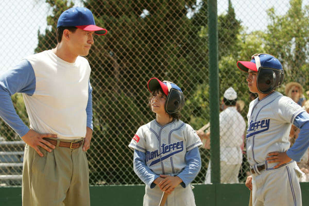 Coach Cesar (Clifton Collins Jr.), left, helps his players Mario and Enrique (Moises Arias and Jansen Panettiere) realize their full potential in The Perfect Game.