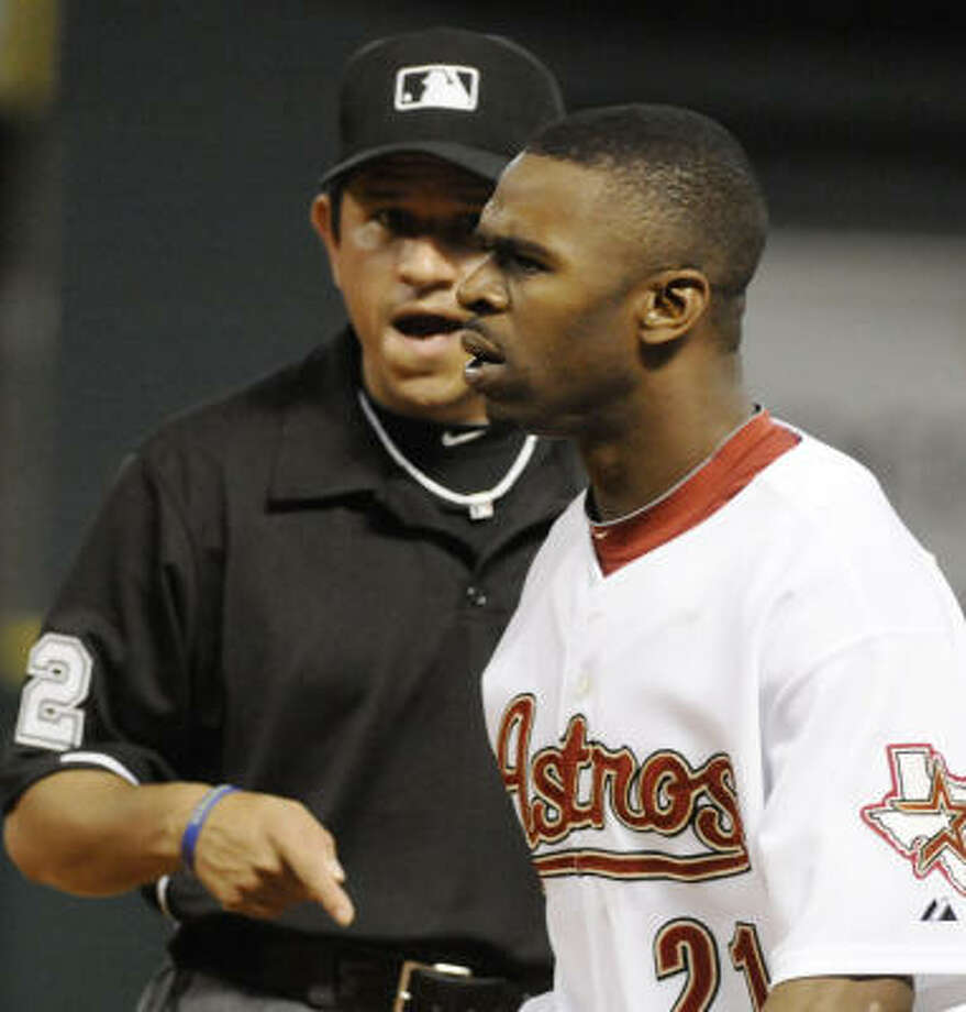 First-base umpire Alfonso Marquez, left, yells at Astros center fielder Michael Bourn before ejecting him in the ninth inning of Saturday's loss to the Padres. Photo: Pat Sullivan, AP