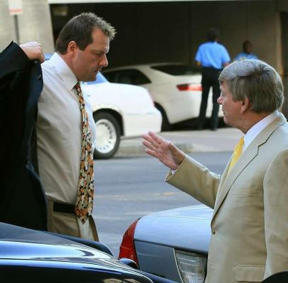 The former pitcher and attorney Rusty Hardin talk outside the courthouse. Photo: Mark Wilson, Getty Images