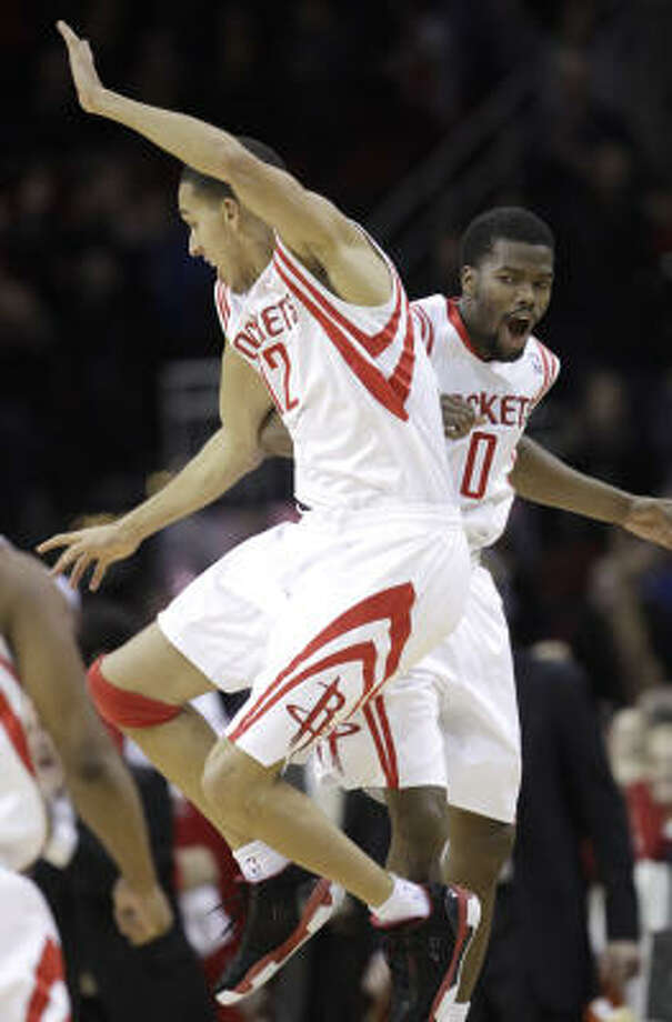 Rockets guard Kevin Martin, left, celebrates with Aaron Brooks after sinking a 3-pointer in the fourth quarter on Monday night. Photo: David J. Phillip, AP