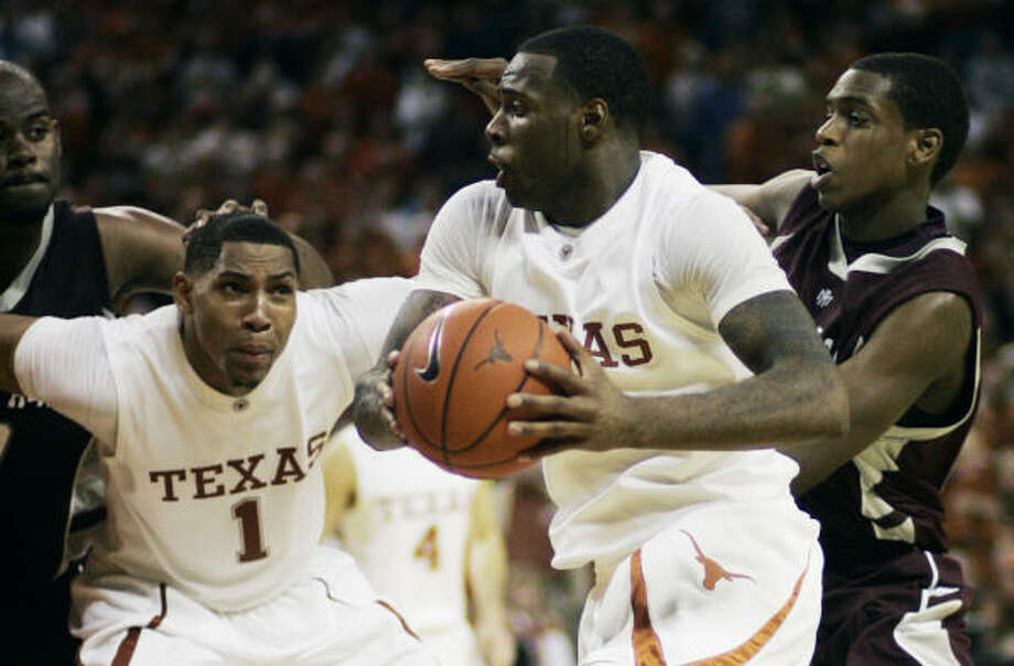Texas A&M freshman Khris Middleton, right, went from watching Texas forward Damion James, center, on television last year to guarding him this season. Photo: Harry Cabluck, AP