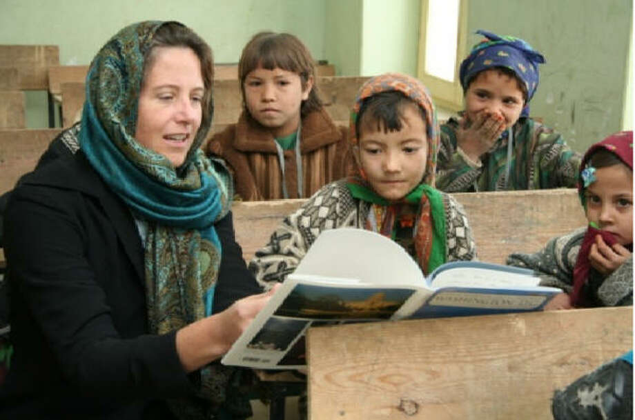 "Education advocate Julie Bolz says the Afghan girls she works with ""want to know all about (Americans), what we wear and do, eat and think. And they ask me, 'Will you tell them about us and what we eat and think?' "" Photo: Handout Photo"