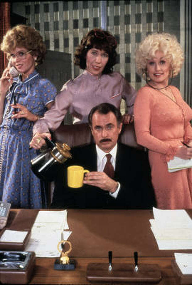Jane Fonda, from left, Lily Tomlin and Dolly Parton play the three coworkers planning revenge on their overbearing boss (Dabney Coleman) in the movie version of 9 to 5. Photo: Twentieth Century Fox