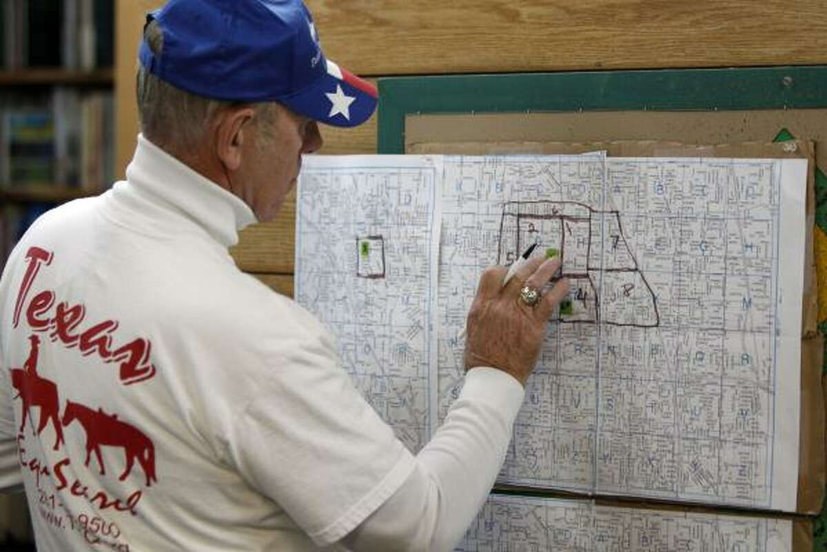 Texas Equusearch search coordinator Ken DeFoor of Dayton works on search grids.