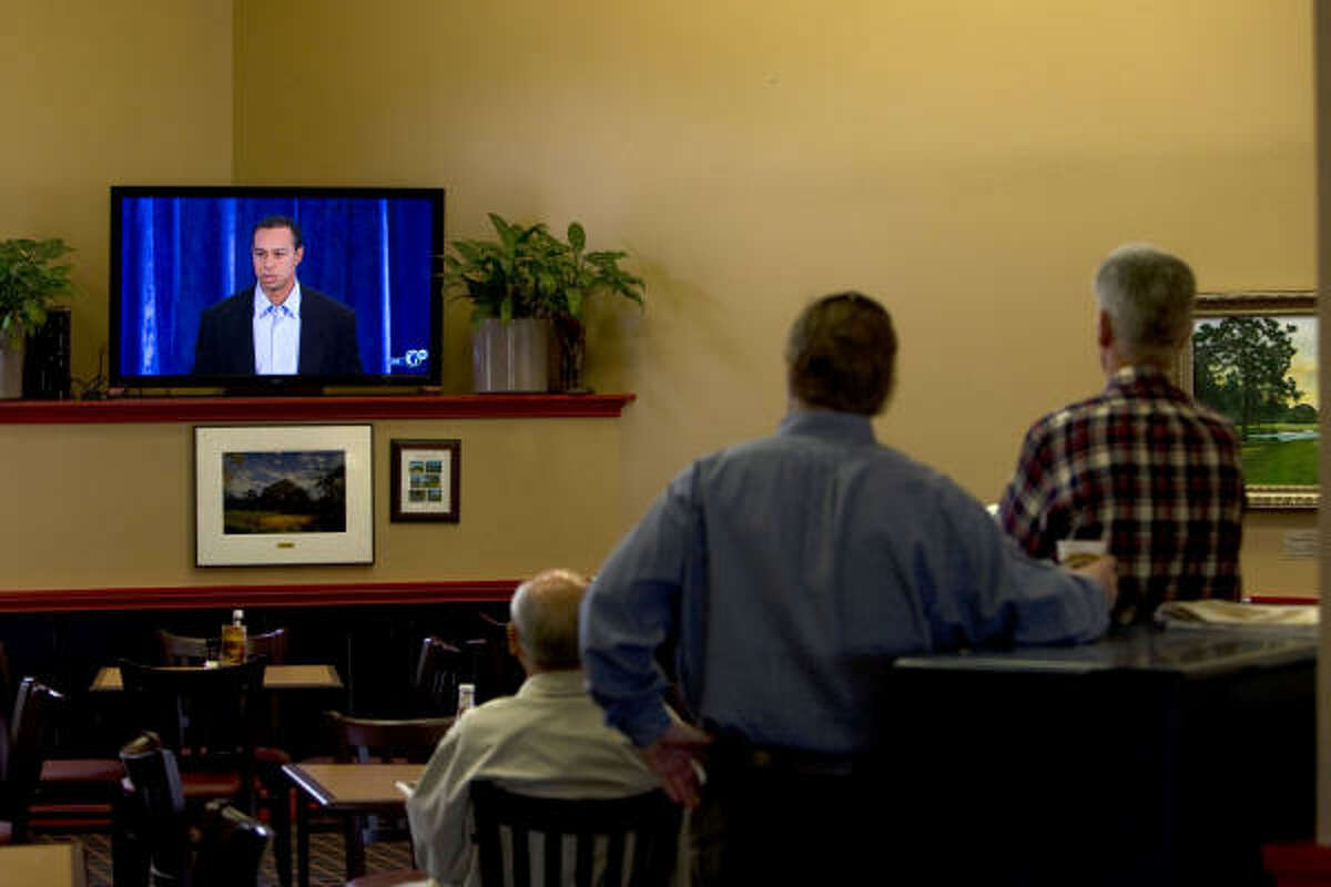 Local golfers at the Becks Prime at the Memorial Park Golf Course watch Tiger Woods' press conference.