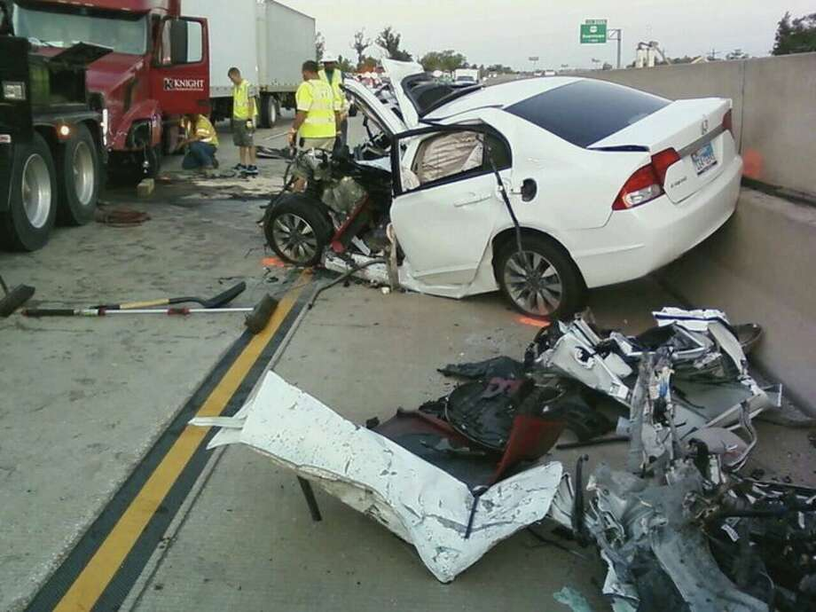 The Texas Department of Public Safety said the woman driving this car was driving the wrong way on Interstate 10 when she ran into an 18-wheeler head-on. Photo provided by The Enterprise's media partner, KBMT Channel 12. Photo: KBMT Channel 12