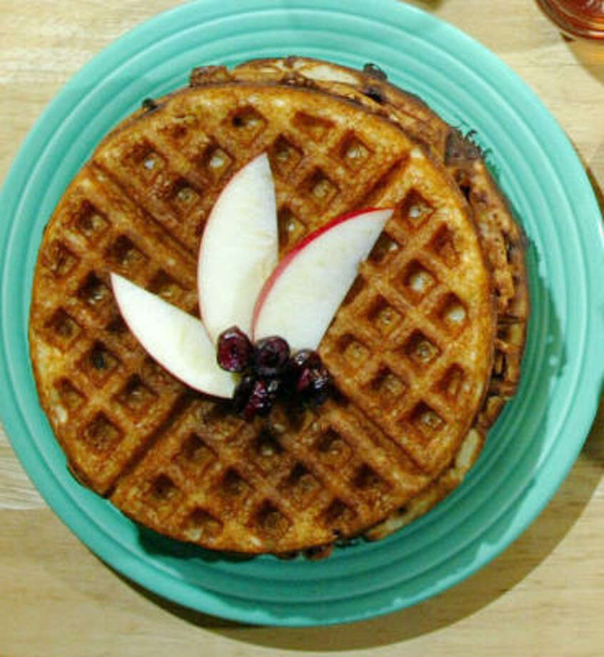 Top waffles with fruit instead of syrup for a more nutritious breakfast. Photo: RODGER MALLISON, FORT WORTH STAR-TELEGRAM
