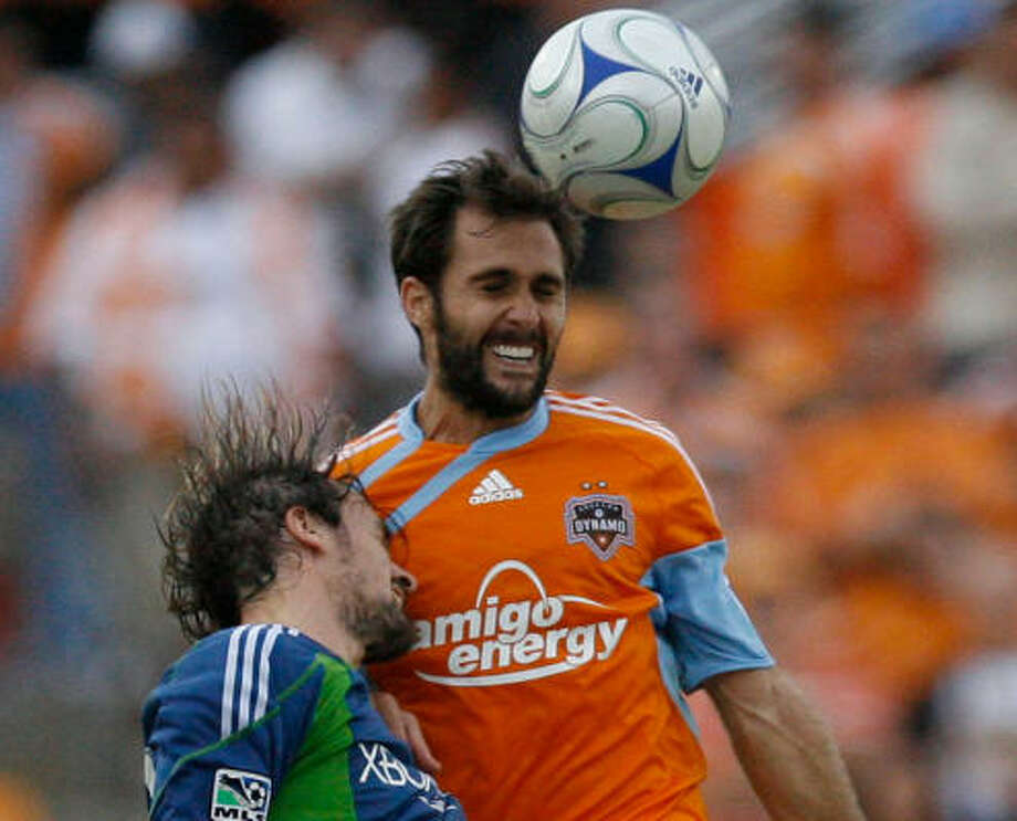 Dynamo midfielder Brian Mullan, right, has played for the franchise since 2003, when it was still in San Jose. Photo: Julio Cortez, Chronicle