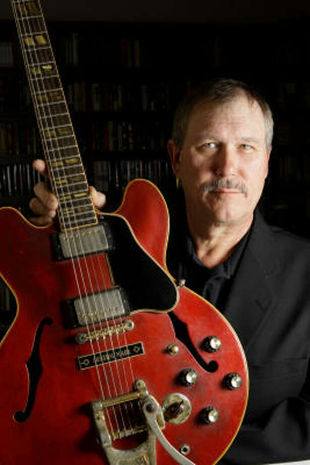 Wil Stich shows the 1963 Gibson ES-345 guitar that belonged to his brother Dave Allen, a masterful Houston blues guitarist who struggled with substance abuse and financial troubles. Photo: Melissa Phillip :, Chronicle