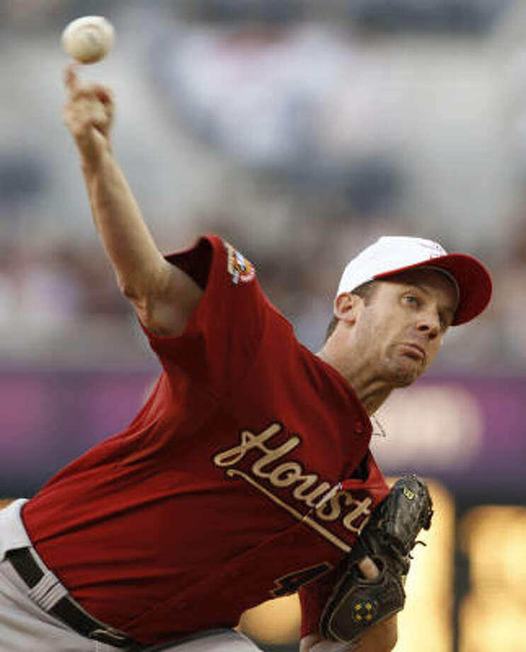 Roy Oswalt pitched seven scoreless innings, striking out seven in a no-decision. Photo: Denis Poroy, AP