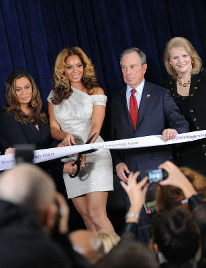 With her mother, Tina Knowles, Beyoncé  cuts the ribbon at the Beyoncé Cosmetology Center at Brooklyn's Phoenix House on Friday. Photo: Jason Kempin, Getty Images