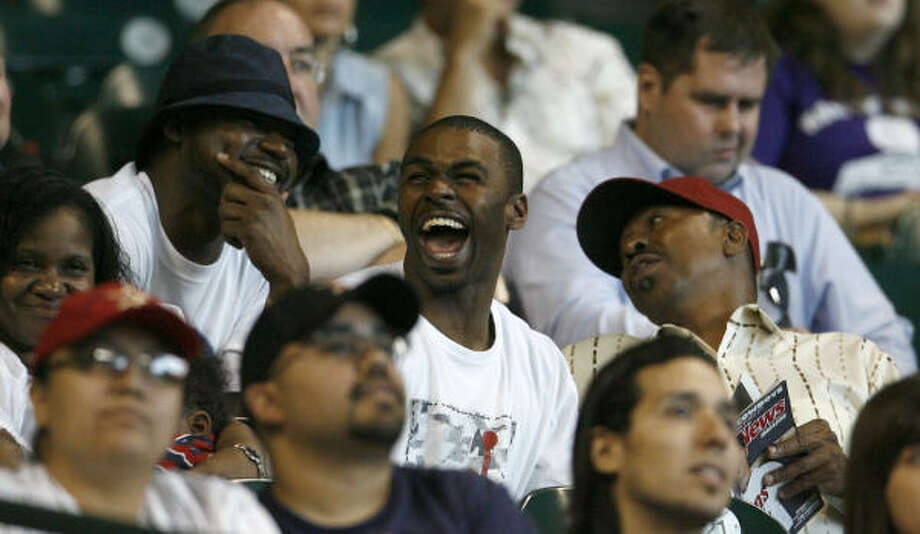 Michael Bourn laughs with friends and family in the stands as he serves his suspension. Photo: Karen Warren, Chronicle