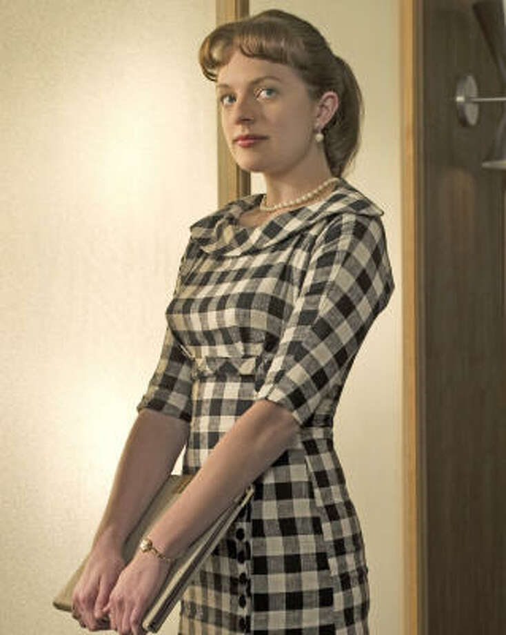 Women have come a long way since the days of AMC's Mad Men, where Peggy Olson, played by Elisabeth Moss, faces a sexist work environment. Photo: AMC
