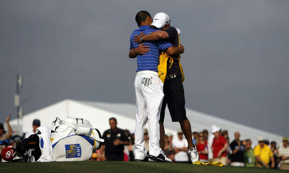 Anthony Kim, left, hugs his caddy, Brody Flanders, after the Shell Houston Open, his third PGA Tour victory. Photo: Johnny Hanson, Chronicle