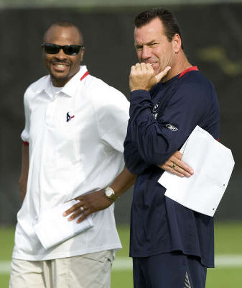 Texans general manager Rick Smith, left, and coach Gary Kubiak have eight picks in seven rounds. Photo: Brett Coomer, Houston Chronicle