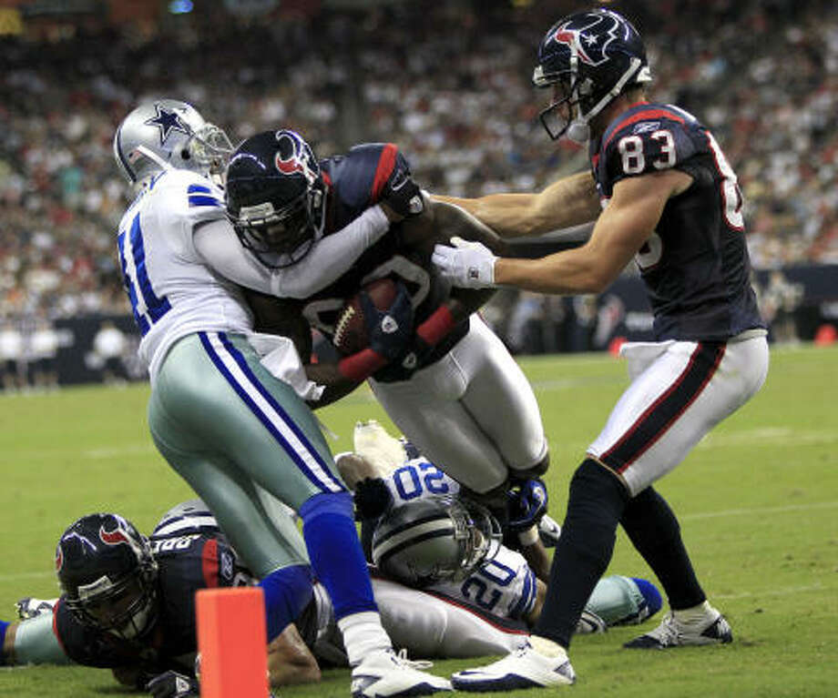 Texans wide receiver Andre Johnson fights for extra yardage in one play which displayed the team's toughness. Photo: Brett Coomer, Chronicle