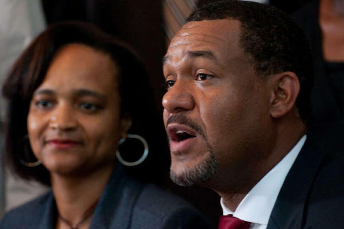 Houston City Councilman Jarvis Johnson and his wife, Charlene, are seent at a July press conference on his arrest.