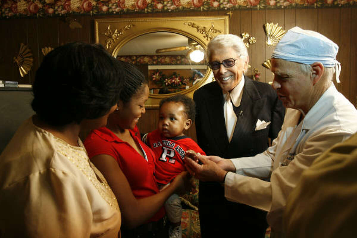 Plastic surgeon Dr. Joseph Agris, at right, and the late Marvin Zindler teamed up to help children throughout the world. In this 2006 photograph, they are shown with some beneficiaries of their charity work: from left, Fonda Burch, her daughter Ronesha Burch, holding son Jeremiah.