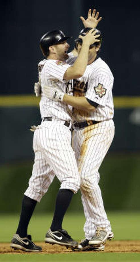 Astros second baseman Jeff Keppinger, left, celebrates with Lance Berkman after his game-winning hit against the Nationals. Photo: David J. Phillip, AP