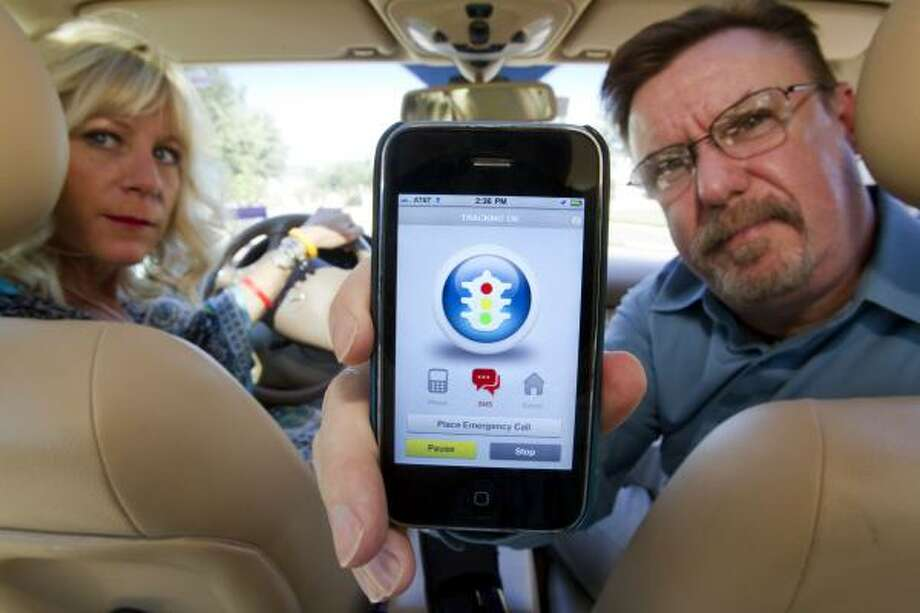 Tina Pantoja and Scott Taylor are marketing an app for drivers who use cell phones. Pantoja, who brought a background in marketing to the venture, and Taylor, who has worked in IT consulting, are neighbors. Photo: Johnny Hanson:,  Chronicle