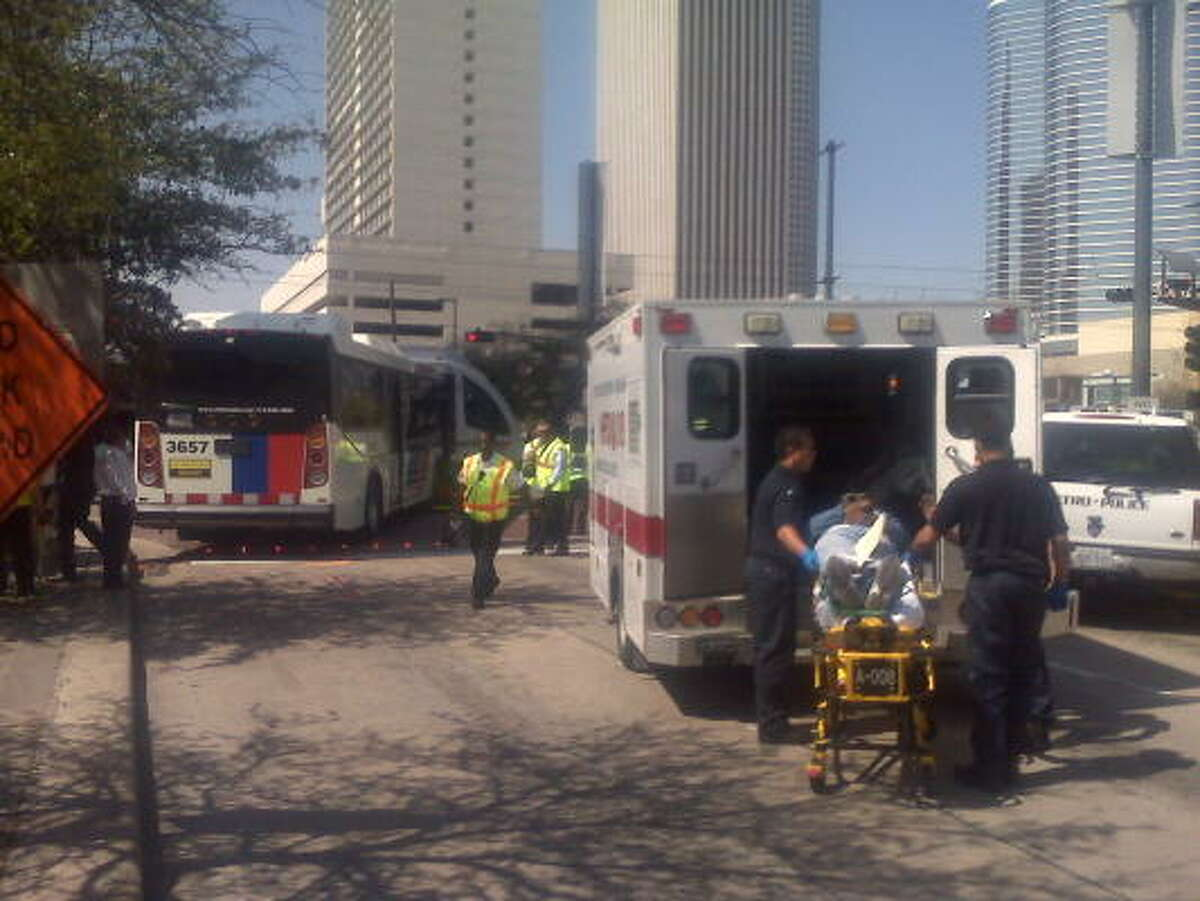 A patient is treated after Monday's collision near downtown Houston.