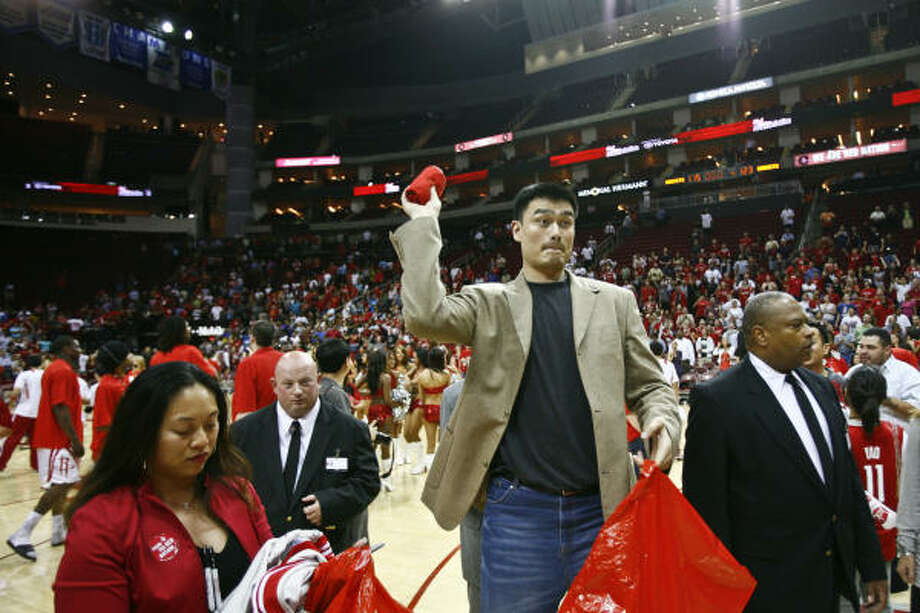 It will take time before Yao Ming, on hand for the Rockets' season finale, returns to 100 percent. Photo: Michael Paulsen, Chronicle
