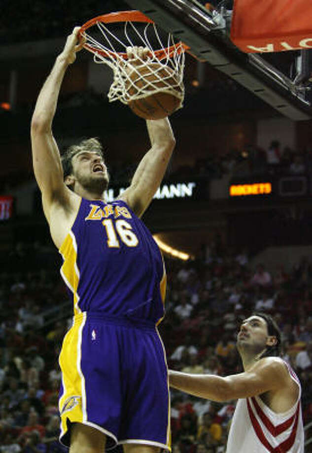 Lakers center Pau Gasol (16) throws down a dunk in front of Rockets forward Luis Scola. Photo: Billy Smith II, Chronicle