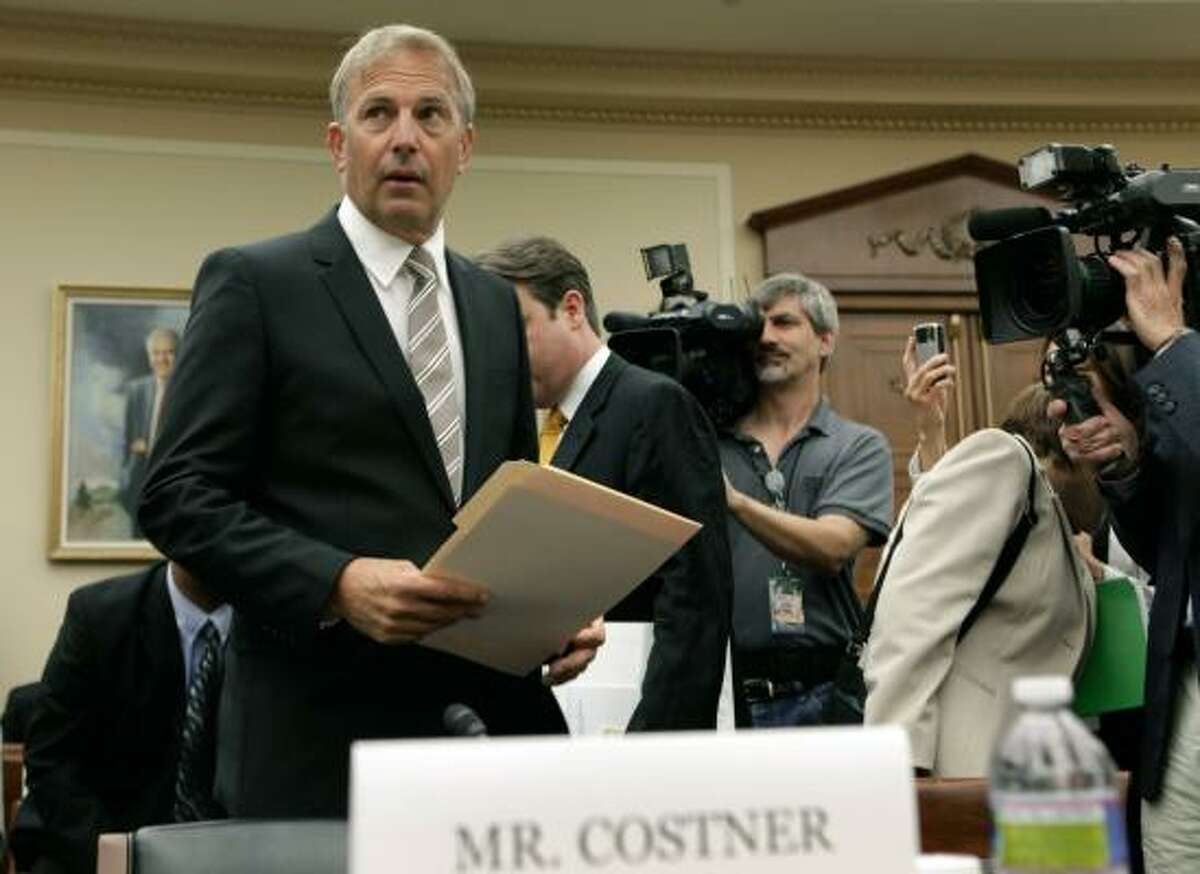 """Actor Kevin Costner arrives Wednesday to testify at a congressional hearing on Capitol Hill. He said he sunk millions into a device to separate oil from water and that """"we ... can bring into the 21st century the technology of oil spill recovery."""""""