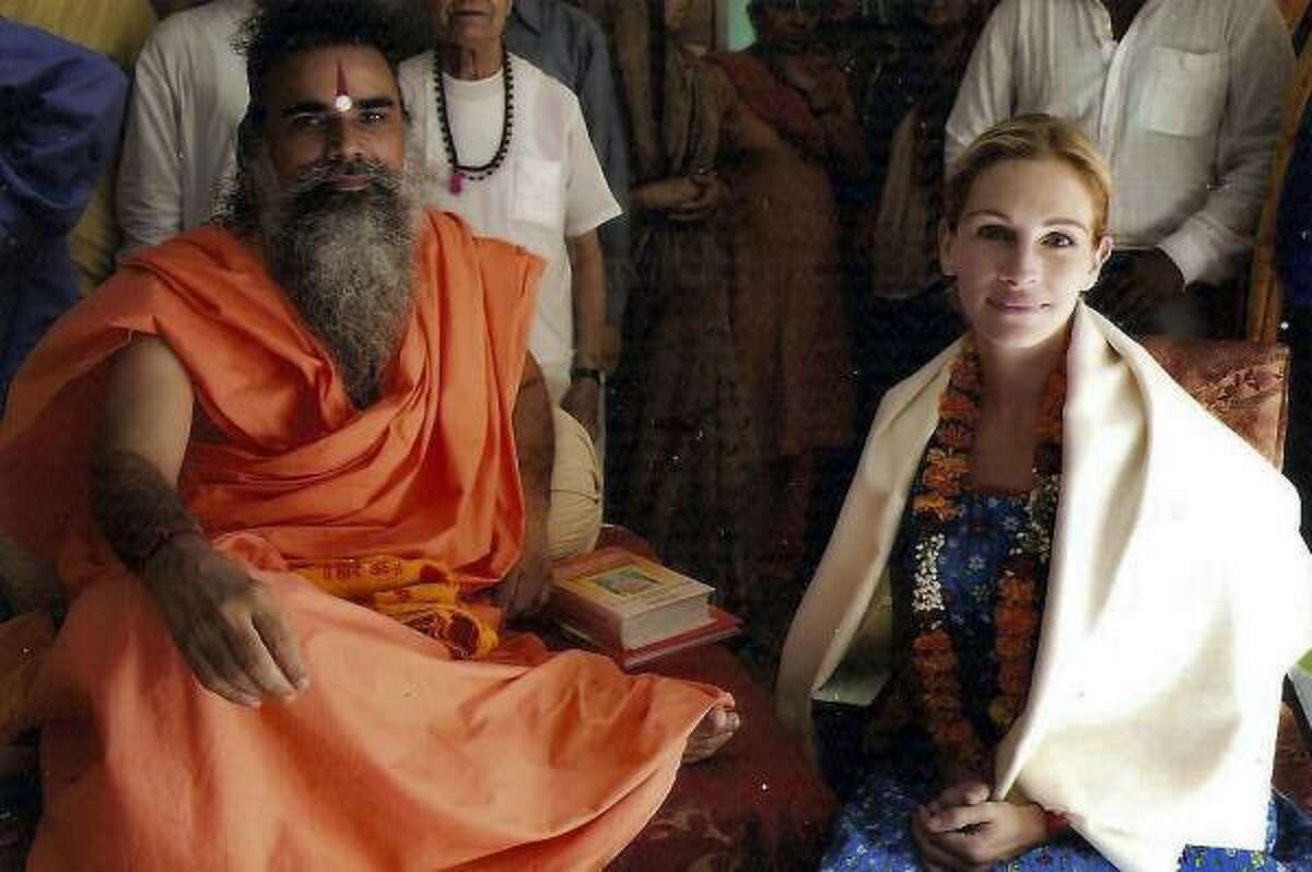 Swami Dharmdev sits at his Hari Mandir Ashram near New Delhi, India, with Julia Roberts during filming of Eat, Pray, Love. Roberts plays author Elizabeth Gilbert, whose memoir provided the basis for the film, which opens Aug. 13.