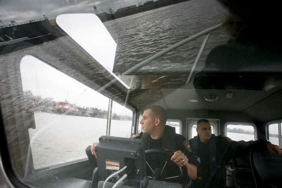 Kacey Haberland, left, and Ken Gates of the Harris County Homeland Security Marine Unit patrol the Houston Ship Channel. Photo: Michael Paulsen :, Chronicle