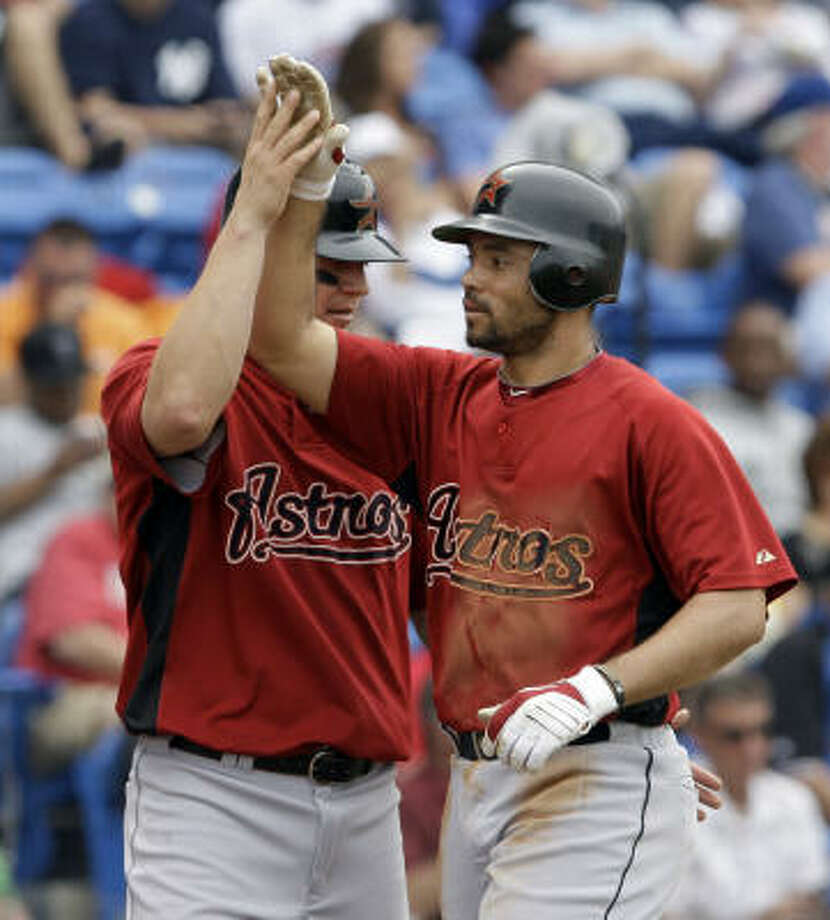 The Astros brought in third baseman Pedro Feliz, right, to help turn the team around. Photo: Richard Drew, AP