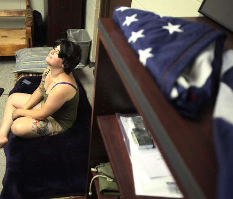 Pfc. Alissa Ingrassia recently completed a nine-month Iraq deployment. Now she's off the Guard payroll, jobless and her car is in the shop. She lives in the Pasadena National Guard Armory, sleeping on couch cushions placed on the floor. Photo: Mayra Beltran, Chronicle