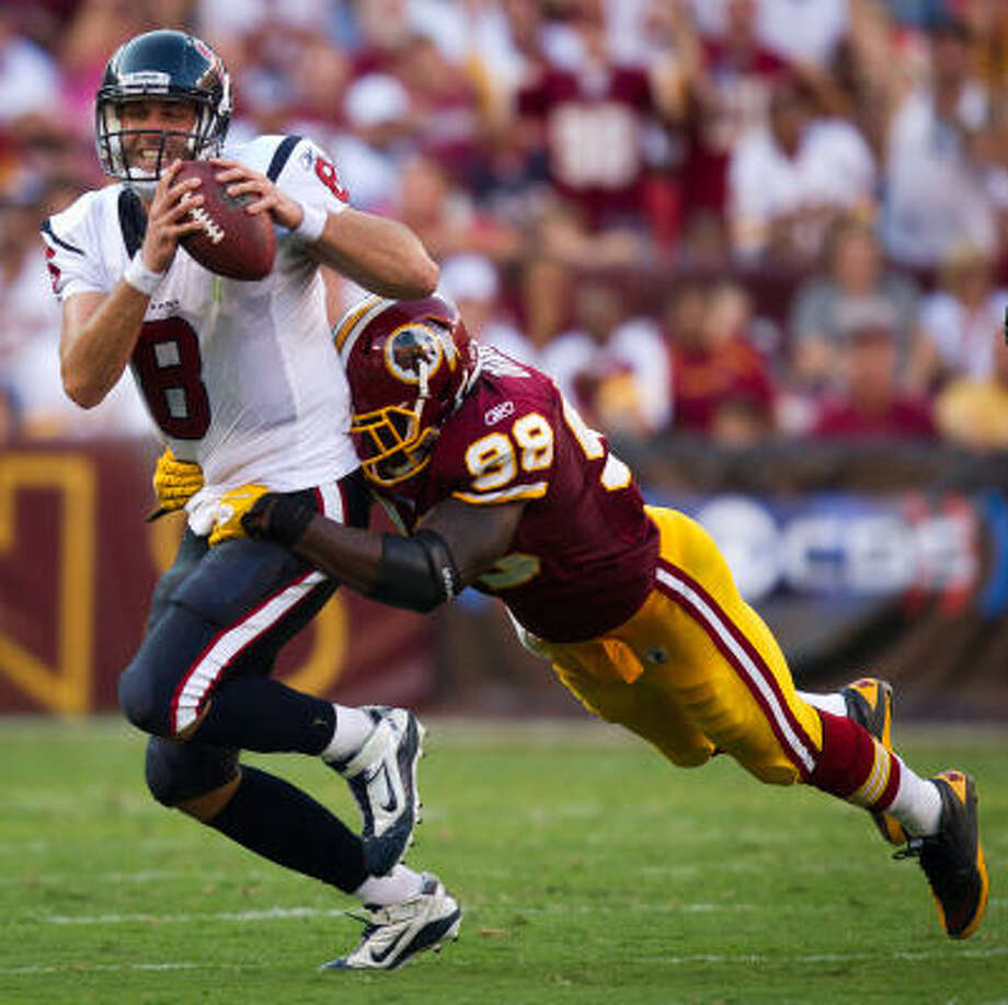 Texans quarterback Matt Schaub is sacked by Redskins linebacker Brian Orakpo in the second half. Schaub was sacked five times during the game. Photo: Smiley N. Pool, Chronicle