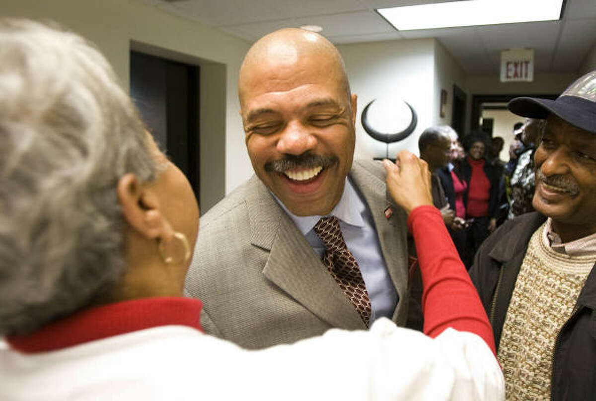 Borris Miles gets a hug from Mary Seymore, his campaign office manager, on Wednesday.