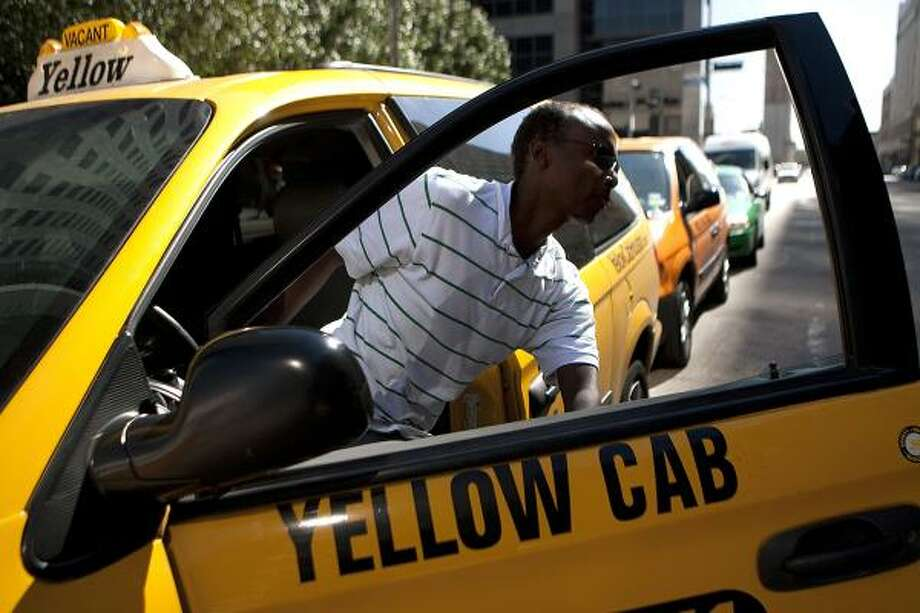 """Samatar Omar, an independent contractor who works for the Yellow Cab company, said he and other cab drivers are becoming more cautious. """"I tell passengers not to do anything stupid because I have you on camera,"""" Omar said. Photo: Johnny Hanson, Chronicle"""