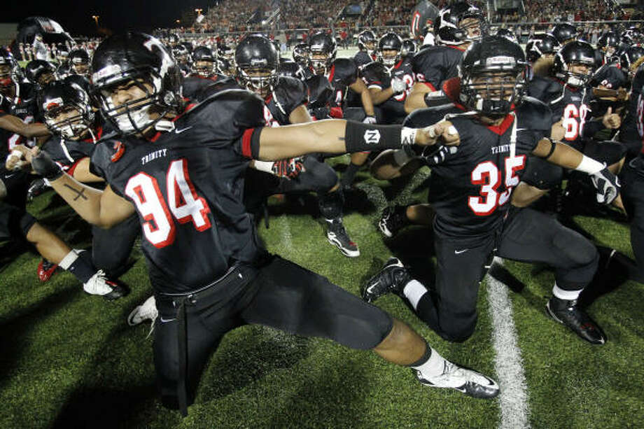 The Euless Trinity players perform their ritual Haka dance last week. Photo: John F. Rhodes, DALLAS MORNING NEWS