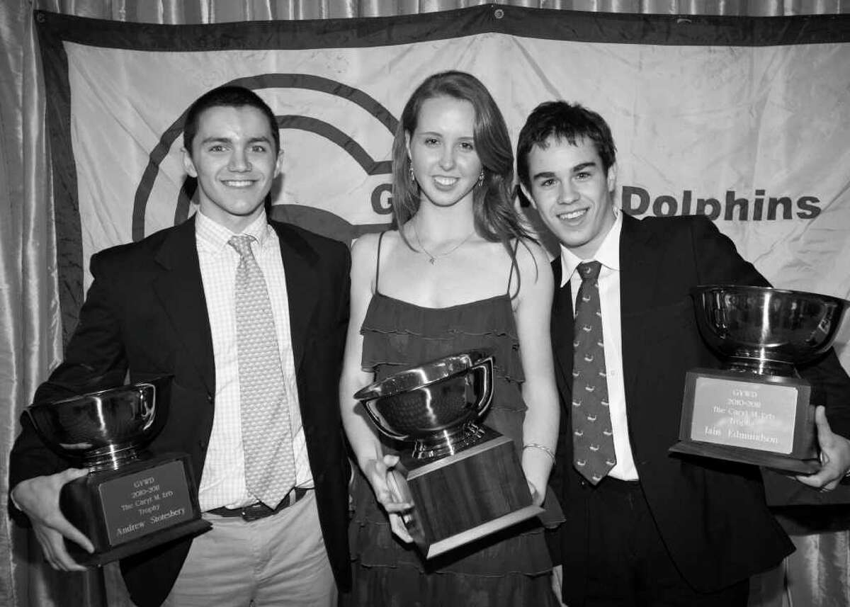 YWCA Greenwich Dolphins Swim Team Caryl Erb Award, which goes to those who inspire others and best demonstrate leadership and dedication, was recently presented to , from left, Andrew Stotesbury, Christine McGuire and Ian Edmundson.